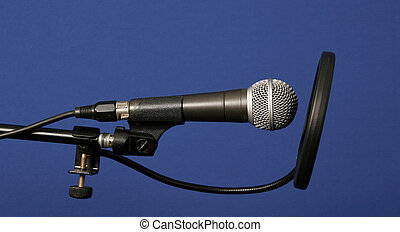 studio microphone with tripod on blue background