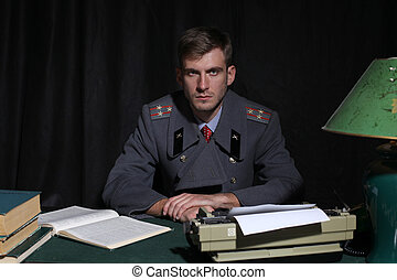 Russian military officer in a dark cabinet