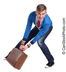 A young man carrying a suitcase