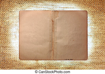 Vintage Grungy Book Pages on Burlap Background