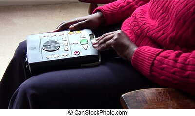 Digital Player - Visually impaired woman listening to audio...
