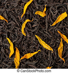 Black tea loose dried tea leaves and sunflower petals