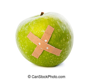 Apple with plaster against white background