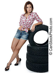 The girl with automobile tyres - Girl with automobile tyres...
