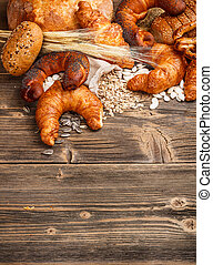 Different types of baked goods on wooden background