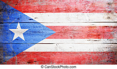 Flags of Puerto Rico painted on grungy wood plank background...