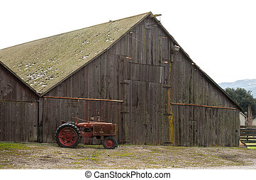 vintage barn with tractor - retro barn with yellow moss and...