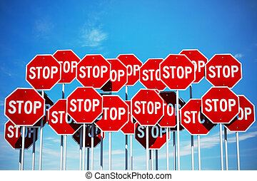 Stop signs on blue sky