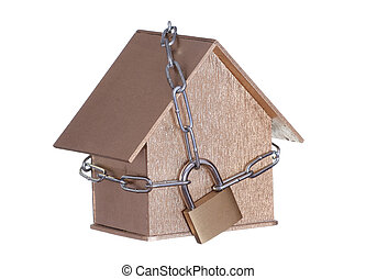 golden home protected with padlock and chain
