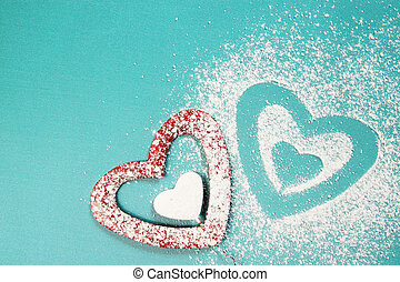 stencil form of heart - Powdered sugar scattered in the form...