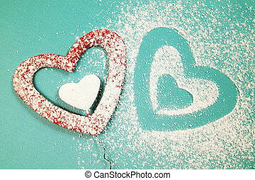 two hearts - Powdered sugar scattered in the form of heart