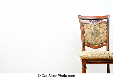 Classic chair on white wall background