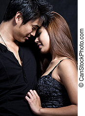 Young attractive asian multiracial couple