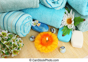 Towels, soaps, flowers, candles - Stack of towels, soaps,...