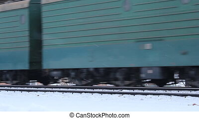 Railway in winter, riding the train
