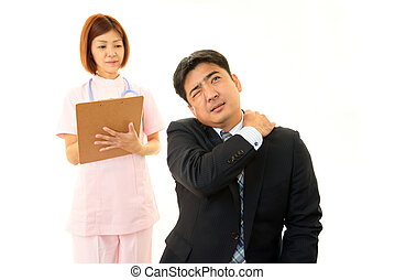 Businessman with shoulder neck pain