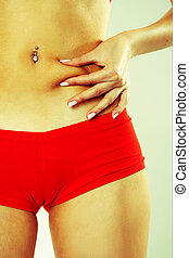 Woman Grabbing at Her Stomach - Woman In Red Active Wear...