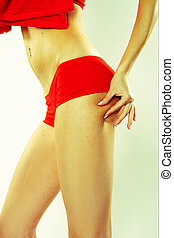 Woman Grabbing at Her Buttocks - Woman In Red Active Weat...