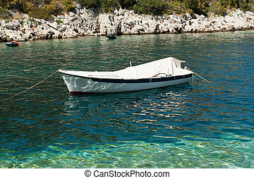 Small white boat on the sea