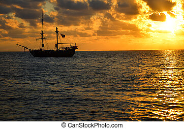 Pirate Ship Sunrise - Orange sunrise with pirate ship on...