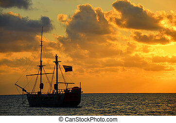 Sunrise over a Pirate Ship - Caribbean sunrise with a pirate...