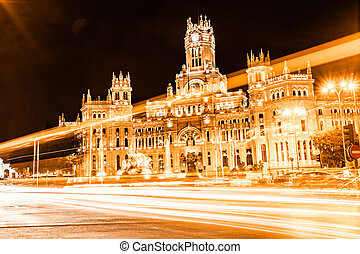 Rush of night time traffic at plaza de cibeles, madrid,...