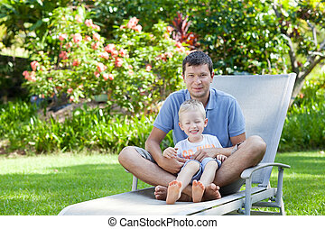 family of two at hawaii vacation - happy father and his son...