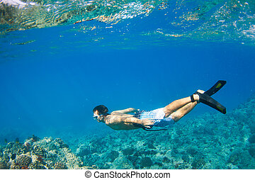 Snorkeling Underwater - Young Man Snorkeling Underwater over...
