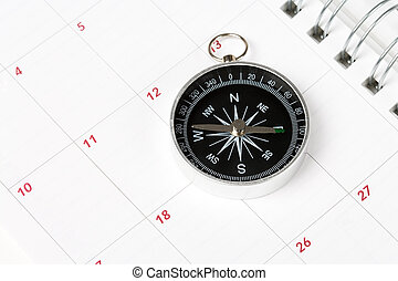 Calendar and compass, concept of time planning