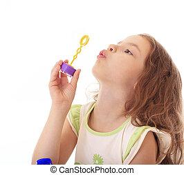 Beautiful little girl blow bubbles