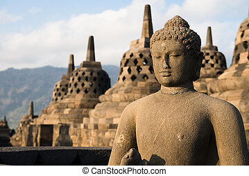 Buggha statue and stupas in Borobudur temple, Indonesia -...