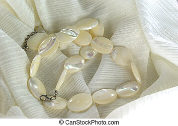 Pearl beads - White pearl oval beads on white fabric
