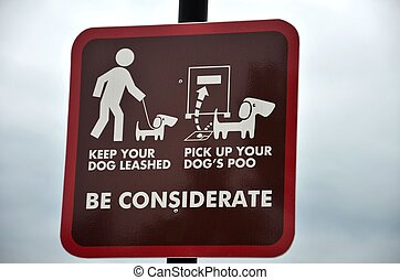 Clean your dog poo sign! - Sign for dog owners at a public...