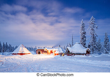 Winter landscape with cabin hut at night in Kiruna Sweden...