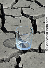 a glass in the dry land - a transparent glass in the dry...
