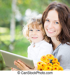 Family using tablet PC outdoors