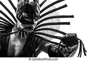 woman in catwoman leather latex fetish wear  silhouette