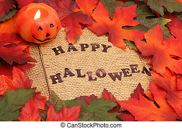happy halloween background with green and oranges leaves...