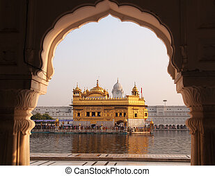 Amritsar Golden Temple - India. Framed with windows from...