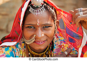 Beautiful Traditional Indian woman in sari costume covered...