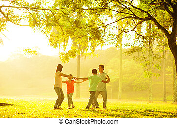 Happy Asian family playing
