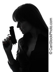 sexy detective woman holding gun silhouette - one caucasian...