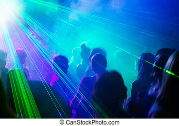 Party people dancing under laser light - Crowd of people...