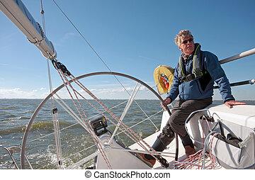 Sailing on IJsselmeer Netherlands - Sailor sailing on the...