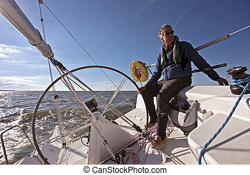 Sailing on IJsselmeer Netherlands - Sailor sailing on the...