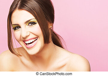 Smiling Young Woman On Pink Background