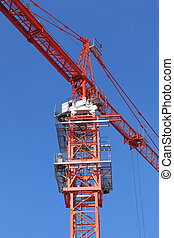 Crane - Red building crane on blue sky