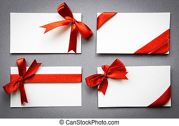 Set of cards with red ribbons bows