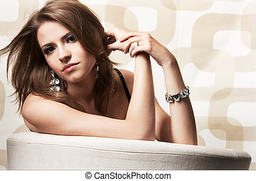 Fashion girl posing on light background