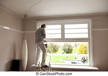 Professional painter inside - Painter working inside a room